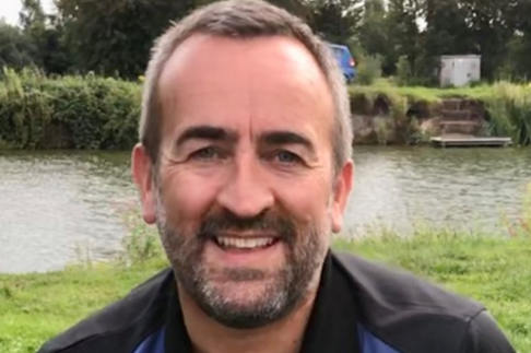 Head and shoulders image of Geoff Kettle, Customer Account Manager. The background features a river and grass banks.