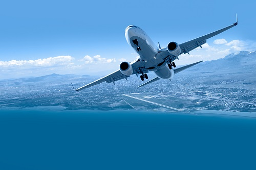 Image of a passenger aircraft taking off over the sea.