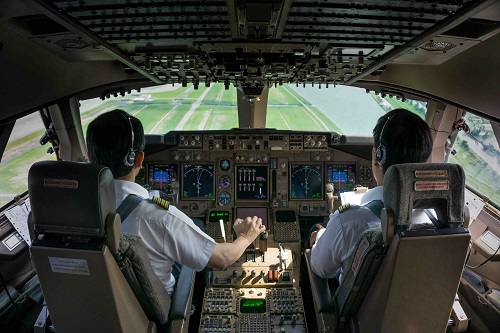 Azores Airlines come on board with skybook. Image shows pilots in the cockpit coming into land
